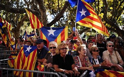 People wave 'estelada' flags, symbolizing Catalonia's independence during a demonstration calling for the independence of Catalonia in Barcelona, Spain, Friday, Sept. 19, 2014. (Photo credit: AP/Manu Fernandez)