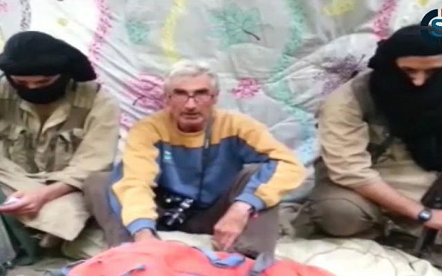 In this still image from video published on the Internet on Monday, Sept. 22, 2014, by a group calling itself Jund al-Khilafah, or Soldiers of the Caliphate, a captive Frenchman appeals to French President Francois Hollande to help free him. The Frenchman, whom the ministry described as a 55-year-old mountain guide, said he was taken hostage by the group on Sunday and reiterated its demands that the French military end its airstrikes in Iraq. The group said it was answering a call by Islamic State group spokesman Abu Muhammad al-Adnani to attack Americans and Europeans. (Photo credit: AP)