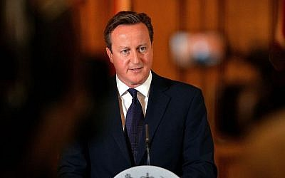 Britain's Prime Minister, David Cameron, makes a statement to the media on the killing of British aid worker David Haines in Downing Street, central London, Sunday Sept. 14, 2014. (Photo credit: AP/PA, John Stillwell)