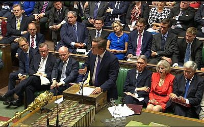 British Prime Minister David Cameron (front, center) speaks during a debate in the Houses of Parliament, Friday, September 26, 2014 (photo credit: AP/Parliamentary Recording Unit)