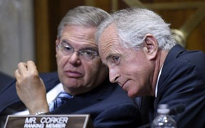 Senate Foreign Relations Committee Chairman Senator Robert Menendez, D-NJ (left), talks with ranking member Senator Bob Corker, R-Tenn. (right), on Capitol Hill in Washington, on July 29, 2014. (photo credit: AP/Susan Walsh, File)