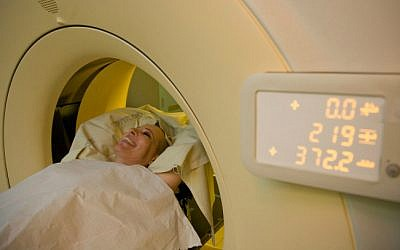 A woman with breast cancer undergoing a CT scan, June 18, 2012. (photo credit: Chen Leopold/Flash90)