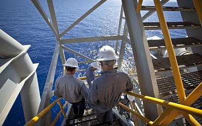 Workers on the Israeli 'Tamar' gas processing rig, 24 km off the Israeli southern coast of Ashkelon. (Moshe Shai/FLASH90)