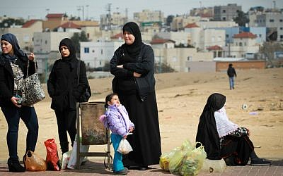 Bedouin women in Rahat waiting for a bus, February 16, 2014. (Hadas Parush/Flash90)