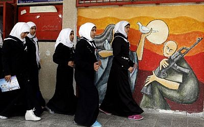 Palestinian girls walk during an awareness training session on the dangers of unexploded ordinances on April 7, 2014, at a school in Khan Younis (photo credit: Abed Rahim Khatib/Flash90)