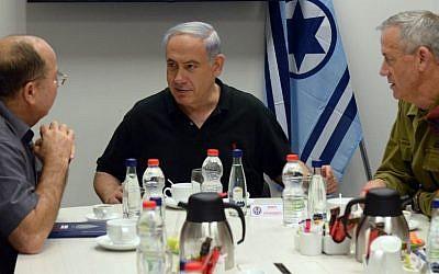 Prime Minister Benjamin Netanyahu (C ), Defense Minister Moshe Ya'alon (R ), and IDF Chief of Staff Benny Gantz (L) visit the Hatzor Israeli Air Force base on August 27, 2014. (photo credit: Haim Zach/GPO/Flash90)