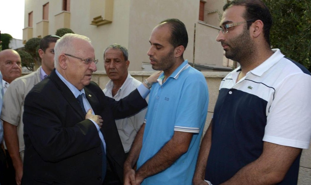 President Reuven Rivlin expresses his condolences to the Hajj Yahya family in Taibe, August 28, 2014 (photo credit: Mark Neyman/Flash90)