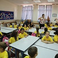 First-grade students are welcomed to the Ben Yehezkel Elementary School in Ashkelon on the first day of the new school year, September 1, 2014. (photo credit: Edi Israel/Flash90)