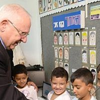 President Reuven Rivlin visits the Agricultural Elementary School, Itzhak Sade, in Dimona, to kick off the new school year on September 1, 2014. (photo credit: Mark Neyman/GPO/Flash90)