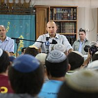 Economy Minister Naftali Bennett speaks to students of the Or Haim Yeshiva in Gush Etzion on September 1, 2014. (photo credit: Flash90)