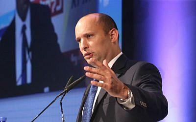 Then-economy minister Naftali Bennett speaks at an economic conference, on September 2, 2014. (photo credit: Flash90)