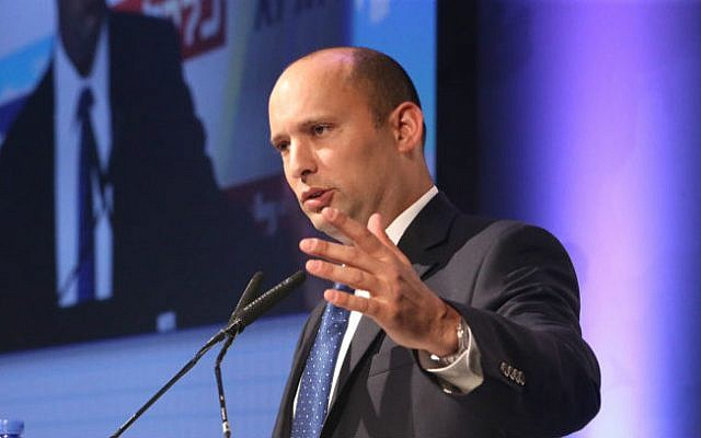 Then-economy minister Naftali Bennett speaks at an economic conference, on September 2, 2014. (photo credit: Flash90)
