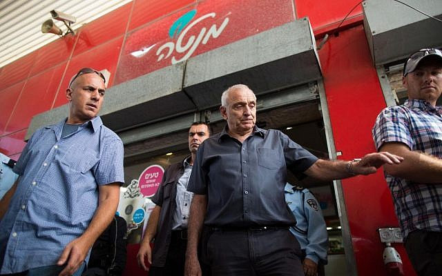 Yitzhak Aharonovitch touring on Tuesday September 9, 2014 the French Hill gas station ransacked by rioters two days earlier. (photo credit: Yonatan Sindel/Flash90)