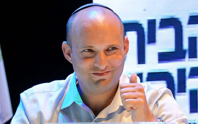 Head of the Jewish Home party, Naftali Bennett, smiles during a party conference on September 10, 2014. (photo credit: Flash90)
