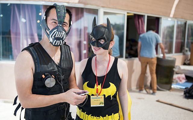 Two characters at GeekCon 2014 show off their superhero regalia (Photo credit: Tal Douek)