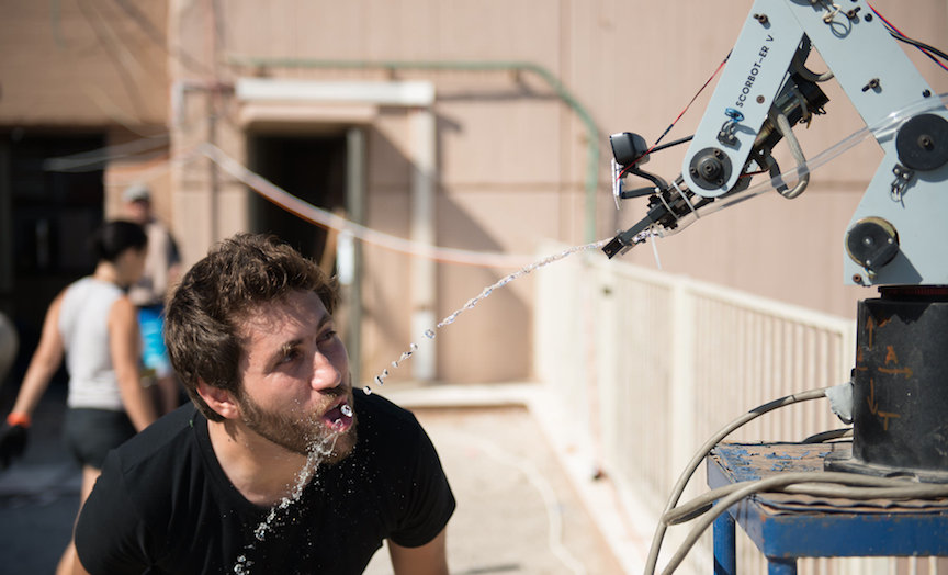 GeekCon's super high-tech water faucet, in which the flow of water is controlled by head movements (Photo credit: Tal Douek)