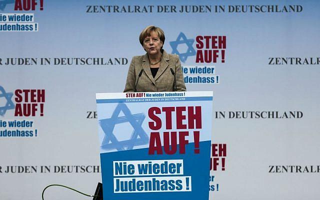 German Chancellor Angela Merkel delivers her speech at a rally against anti-Semitism near the Brandenburg Gate in Berlin, September 14, 2014.  (AP/Markus Schreiber)