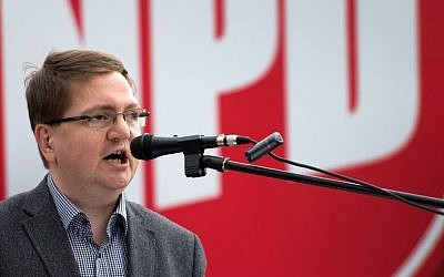 The chairman of the National Democratic Party of Saxony State, Holger Szymanski, speaks during an May 2014 election rally in Dresden, eastern Germany. (photo credit: AP Photo/dpa, Arno Burgi, file)