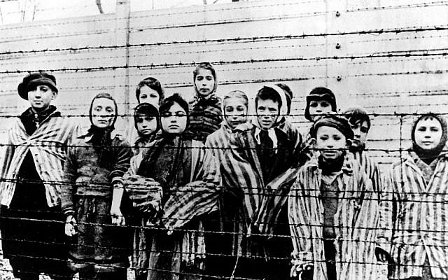 This picture from January, 1945 shows a group of children wearing concentration camp uniforms  (Auschwitz) Nazi concentration camp,  just after their liberation by the Soviet army. (photo credit: AP Photo)