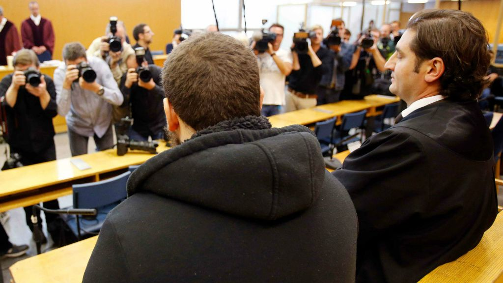 German Kreshnik Berisha, left, waits for the beginning of his trial at a higher regional court in Frankfurt, Germany, Monday, Sept.15, 2014. He is accused of having been a member of the Islamic state group in Syria. (photo credit: AP/Michael Probst)