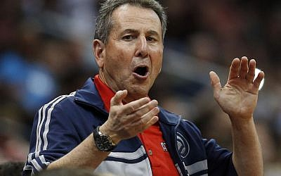Atlanta Hawks co-owner Bruce Levenson cheers from the stands in the second half of Game 4 of an NBA basketball first-round playoff series against the Indiana Pacers in Atlanta in April 2014. (photo credit: AP/John Bazemore)
