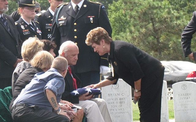 Florence Gantt, a volunteer who consoles mourners at Arlington National Cemetery, speaks to David Rogers, the nephew of Pfc. Bernard Gavrin who died in Saipan in 1944 and who was buried September 12 2014 (Photo credit: Ron Kampeas/JTA)