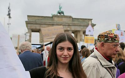 Julia, a Christian Syrian refugee from Damascus, attended the Berlin protest against rising German anti-Semitism. She said many Syrians support Israel but are afraid to say so publicly. (Micki Weinberg/The Times of Israel)