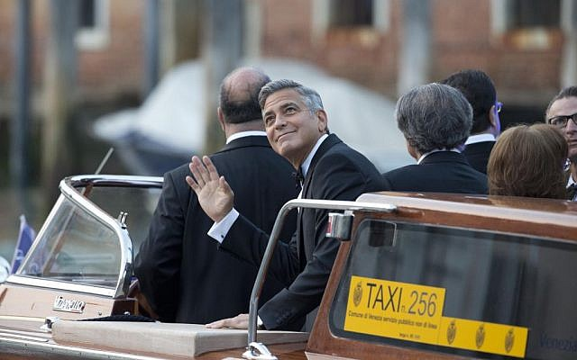 George Clooney on his way to marry Amal Alamuddin, in Venice, Italy, Saturday, Sept. 27, 2014. (photo credit: AP Photo/Andrew Medichini)