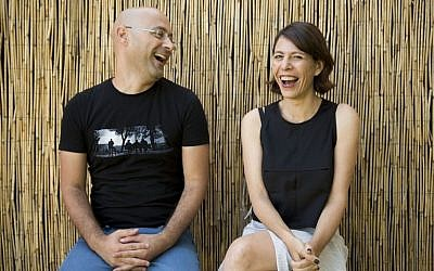 Directors Tal Granit, right, and Sharon Maymon laugh as they pose for photographs following an interview with The Associated Press for their film The Farewell Party, during the 71st edition of the Venice Film Festival in Venice, Italy, Thursday, Aug. 28, 2014. (Photo credit: AP/David Azia)
