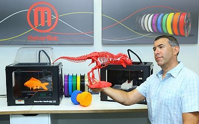 MakerBot Israel's Arik Shefet holds a MakerBot creation (Photo credit: Courtesy)