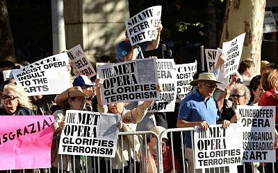 Protestors attend the arrivals at Metropolitan Opera 2014-15 Season Opening on Monday, Sept. 22, 2014, in New York. The crowd was protesting the Met's decision to premiere a controversial opera 'Death of Klinghoffer,' about the hijacking of the Italian cruise ship Achille Lauro and the murder of Jewish passenger Leon Klinghoffer. (Photo by Evan Agostini/Invision/AP)