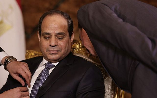 Egyptian President Abdel-Fattah el-Sissi confers with an aide before an interview at the presidential palace in Cairo, Saturday, Sept. 20, 2014 (photo credit: AP/Maya Alleruzzo)