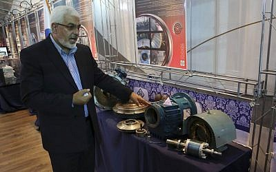 Atomic Energy Organization of Iran head Asghar Zarean points at parts he says were exported to the country with alleged purpose of sabotage and spying on Iran's nuclear facilities, in Tehran, Iran. (AP Photo/Vahid Salemi)