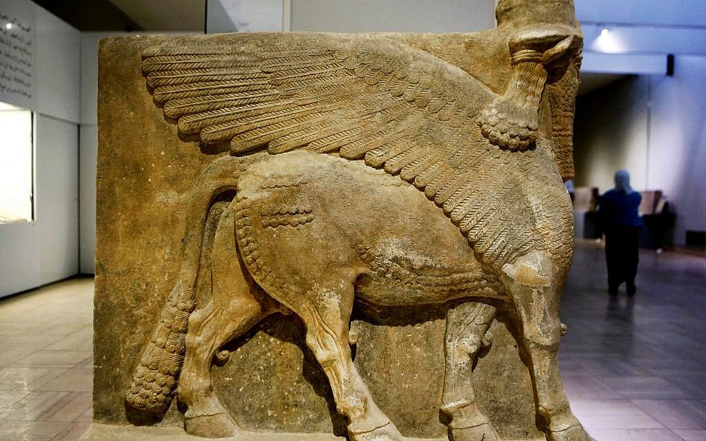This Monday, Sept. 15, 2014 photo shows a winged bull made out of limestone displayed at the Iraqi National Museum in Baghdad. (AP Photo/Hadi Mizban)