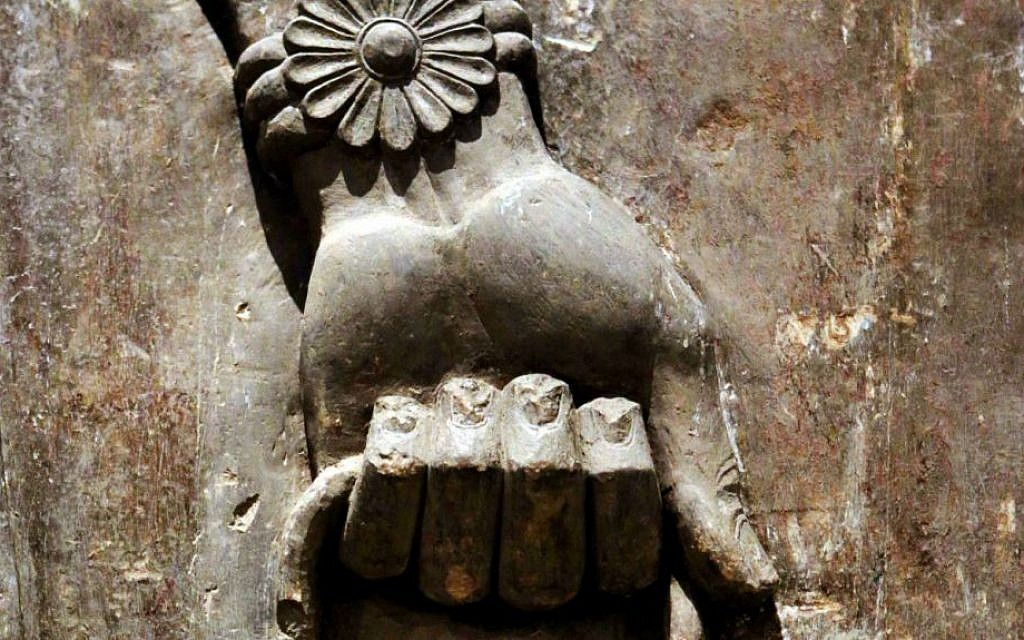 This Monday, Sept. 15, 2014 photo shows the detail of a hand, part of a statue displayed at the Iraqi National Museum in Baghdad. (AP Photo/Hadi Mizban)