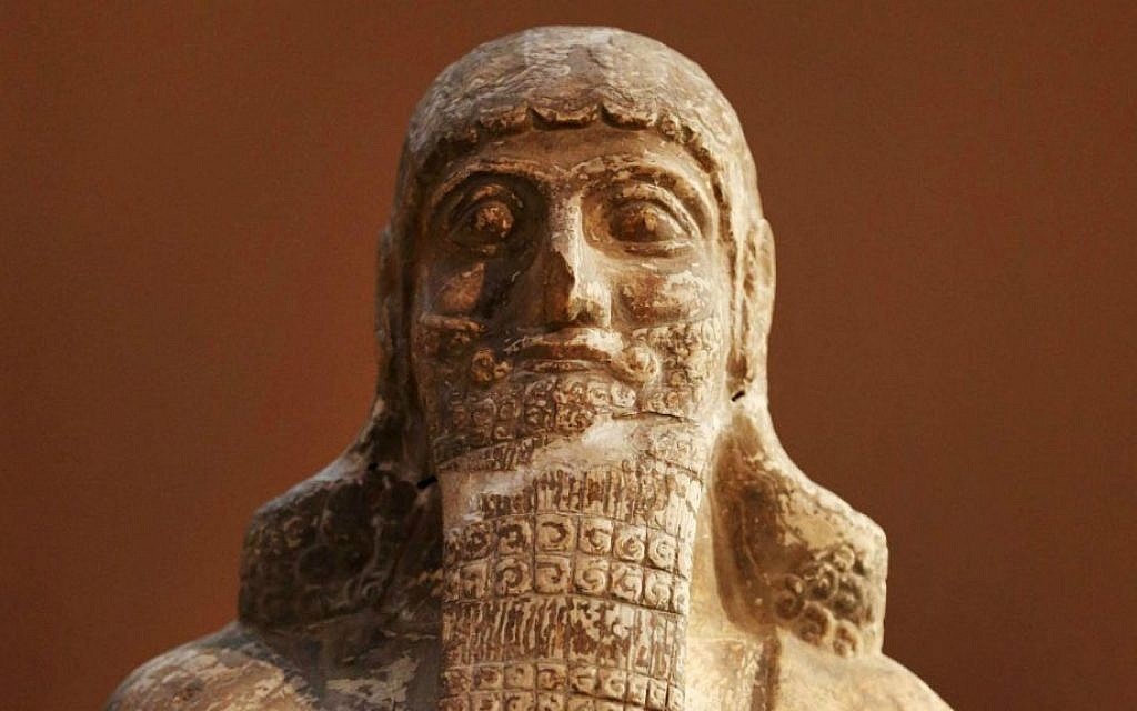 This Monday, Sept. 15, 2014 photo shows a stone statue displayed at the Iraqi National Museum in Baghdad. (AP Photo/Hadi Mizban)