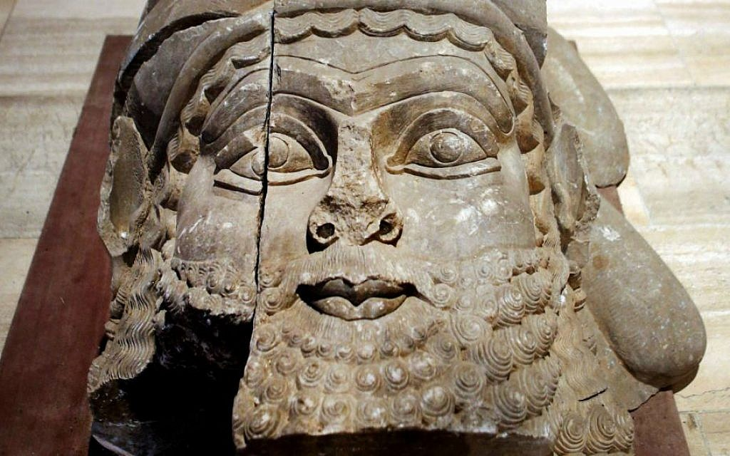 This Monday, Sept. 15, 2014 photo shows the head of a winged bull made out of limestone restored and displayed at the Iraqi National Museum in Baghdad. (AP Photo/Hadi Mizban)