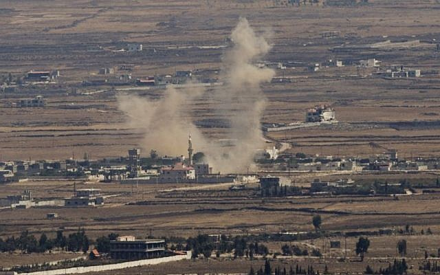 Illustrative: Smoke rises following an explosion in Syria's Quneitra province as Syrian rebels clash with Assad regime forces, seen from the Golan Heights in 2014. (AP/Ariel Schalit, File)