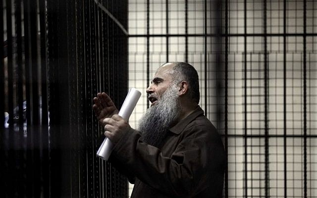In this Sunday, September 7, 2014 file photo, radical al-Qaeda-linked preacher Abu Qatada speaks to the press prior to his verdict at the Jordanian military court in Amman, Jordan. (photo credit: AP/Mohammad Hannon, File).