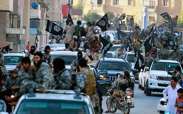 Fighters from the Islamic State group parade in Raqqa, north Syria, in June 2014. (AP/Raqqa Media Center of the Islamic State group/File)