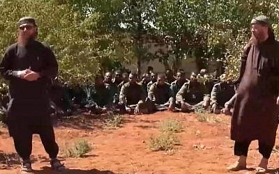 This image made from video posted on a militant social media account on Thursday, Sept. 11, 2014 shows U.N. peacekeepers from Fiji, background, held captive by militants from the Nusra Front in Syria. Al-Qaida-linked Syrian rebels on Thursday released all 45 Fijian peacekeepers they had held captive for two weeks, the United Nations said, bringing an end to a crisis that had pulled the U.N. monitoring force into the chaos of Syria's civil war. (photo credit: AP Photo via militant social media account)