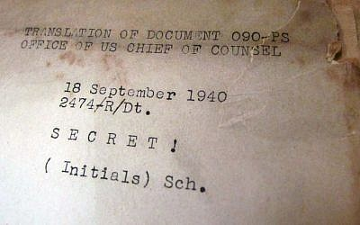 This photo dated Friday, Sept. 19, 2014, in Anchorage, Alaska, shows a Nuremberg trial document that belonged to Maxine Carr, a stenographer who was assigned to cover the war-crimes trials after World War II. Carbon copies of trial transcripts and other Nuremberg mementos from the late Anchorage resident are being auctioned off Saturday through the Alaska Auction Co. (AP Photo/Rachel D'Oro)
