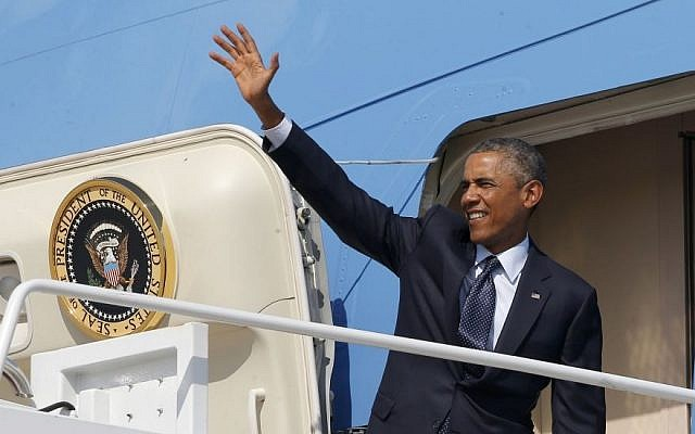 President Barack Obama waves as he boards Air Force One at Andrews Air Force Base, Md., Tuesday, Sept. 2, 2014, as he begins his trip to Estonia and Wales for the NATO Summit. (Photo credit: AP/Charles Dharapak)