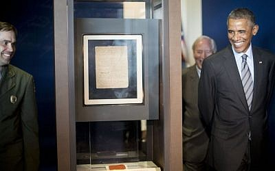 US President Barack Obama walks toward the original manuscript of the 'Star Spangled Banner' during his tour of Fort McHenry Visitor and Education Center in Baltimore, Friday, Sept. 12, 2014. (AP Photo/Pablo Martinez Monsivais)