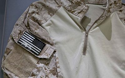 In this September 5, 2014 photo provided by the National September 11 Memorial and Museum, the fatigue shirt worn by the US Navy SEAL during the mission to capture Osama bin Laden, is seen in a case at the museum in New York. (photo credit: AP/National September 11 Memorial and Museum, Jin Lee)