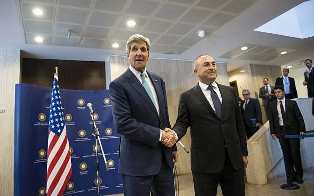 US Secretary of State John Kerry, left, shakes hand with Turkey's foreign minister Mevlut Cavusoglu upon his arrival at the Ministry of Foreign Affairs in Ankara, Turkey, on Friday, September 12, 2014. (AP Photo/Brendan Smialowski, Pool)