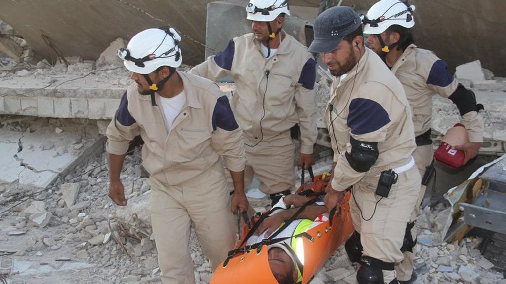 In this photo posted on August 21, 2014, Syrian civil defense rescuers in white