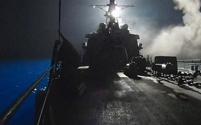In this image made from video released by the U.S. Navy on Tuesday, Sept. 23, 2014, missiles bound for Syrian Islamic State group targets are launched off of a U.S. Navy ship.  (AP Photo/U.S. Navy via AP video)