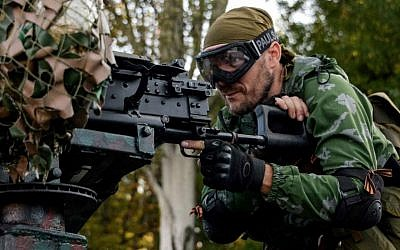 A Pro-Russian rebel prepares arms for the the assault on the positions of Ukrainian army in Donetsk airport, eastern Ukraine, Sunday, Aug. 31, 2014. (AP Photo/Mstislav Chernov)
