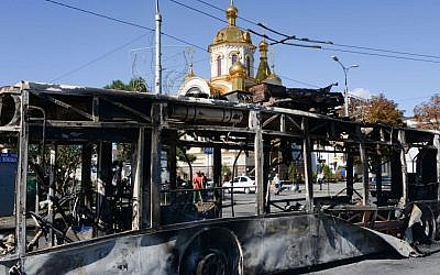Illustrative image of a burned trolleybus near Donetsk train station after shelling, Donetsk, Ukraine, Saturday, Aug. 30, 2014. (AP Photo/Mstyslav Chernov)